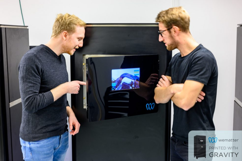 Tomas, a newly hired materials physicist, shows Henrik how the latest 3D print turned out on the Gravity 2020.